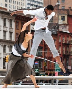 Carmen Nicole Smith and Sean Scantlebury of Battery Dance Company perform against New York's cityscape during the Downtown Dance Festival. Photo courtesy Battery Dance Company.