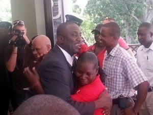 Premier-Elect Donaldson Romeo embraces a supporter after his swearing in ceremony at Government House on Friday 12th September 2014. Full election results can be found at <i>www.elections.ms</i>
