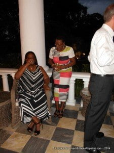 Senators Kerry Anne Ifill (seated) and Maxine McClean sharing a beverage and memories at the British High Commission's autumn reception on Saturday 13 September to celebrate the 'Last Night of the Proms'.