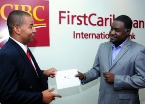 Gregory Blackman, Manager, Sales & Business, CIBC FirstCaribbean (left) talks about entrepreneurship with Paul Clarke, co-executive producer of Flying Fish Studios Inc. which produces TV show Entrepreneurs Anonymous. The bank has recently thrown its support behind the series.