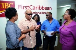 Rudyard Welch, President of the National United Society for the Blind (second from left) and Roger Vaughan, Vice President chat about the society's plans and work with (from left) CIBC FirstCaribbean's Nicole Weekes, Senior Trust Officer, Barbados Wealth and Asset Management; Egan Pollard, Executive Administrative Assistant; and Paige Bryan, Manager, Retail Banking Channels.