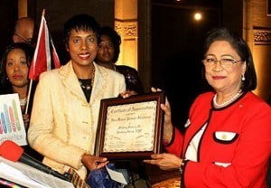 Invest Caribbean Now Founder/Chairman Felicia Persaud (left) presents a certificate of appreciation to Trinidad & Tobago Prime Minister Kamla Persad-Bissessar as ICN President Sheila Newton-Moses, far left, looks on. (Hayden Roger Celestin image)