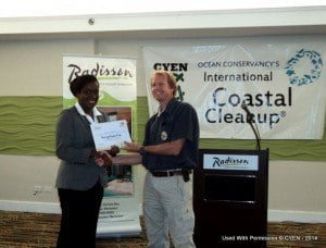 Garbage Master Ltd receiving the ICC recognition award from Ms. Sade Deane of CYEN-Barbados