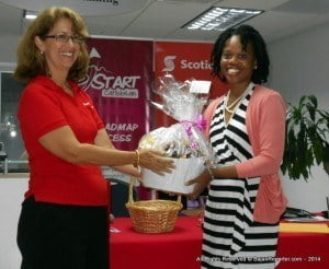 "Bank on Me's goal is to make Barbadians aware as to how small and medium sized businesses can attract investment in an unusual yet contemporary format, and ultimately it seeks to develop and elevate entrepreneurship in Barbados and the Caribbean. Thus making (AT RIGHT, RECEIVING A TOKEN OF APPRECIATION FROM SCOTIA'S Sr Mktg Mgr LISA COLE)Heather Barker's desire to see the phrase ""Tough Economic times,"" gain a well deserved interment become one step closer to reality!"
