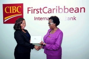 Paige Bryan (RIGHT), Manager, Retail Banking Channels, CIBC FirstCaribbean (right) presents Abena Agard (LEFT), President, JCI Barbados with funds to assist with the organisation's outreach at the Government Hill Nursery School.