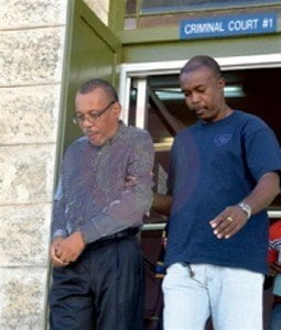 (IMAGE VIA - nationnews.com) Rodney Wilkinson (left) being escorted from court on Saturday. (Picture by Xtra Vision Photography)