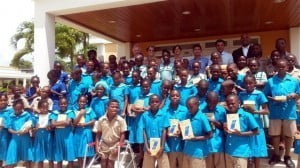 Students from St Joseph Primary School with their tablets from the Aron & Christina Foundation. (Standing in the back Mr. Nicholas Williamson, Christina & Aron Truss, Jaggernauth Dass and MP Dale Marshall)