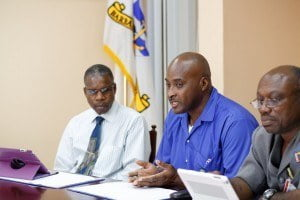Marcellus Louis, docker, speaks about the benefits of on-the-job training while Peter Carrington, Human Resources Manager, Barbados Port Inc. (left) and Emerson Alleyne, Caribbean Maritime Institute (CMI) listen.