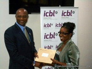 Henry Inniss (Left), Senior VP and Head of the Life Division at ICBL, is presenting Margo Bannister (Right), Second Vice President of NUPW, with a financial contribution for the development of the NUPW Education Outreach School.