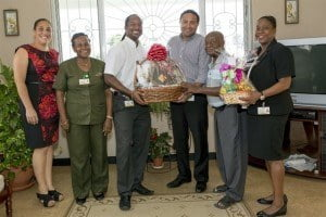 Mount Gay staff members showed their appreciation to Carlton Daniel (second from right), a Mount Gay wholesaler since 1956, when they dropped by his Regency Park home and business to deliver gift baskets on behalf of the company. Staff from left included Carla Jackson, Angela Frederick, Marc MCollin, David Sealy, and Candace Browne.