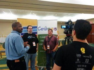 Carlos Martinez (second from left), chief technology officer of the regional Internet registry for Latin American and the Caribbean (LACNIC) and Mark Korsters, chief technical officer of the American Registry of Internet Numbers (ARIN), talk with media at CaribNOG 8, Hilton Curacao, Willemstad, September 30. Photo courtesy: LACNIC.