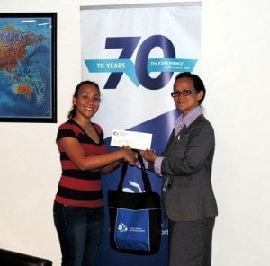 Ms. Suenah Martis of the SSA (left) is seen receiving the sponsorship check from Suzy Kartokromo, Acting Manager, Marketing and Customer Service Dept., SXM Airport. (SXM photo)