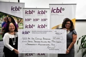 Ingrid Innes (right), Managing Director and CEO of ICBL presents Sharen Lady Carmichael, a member of the Organizing Committee for the Multi-National Fair, with the sponsorship cheque.