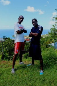 Jerry Bascombe (white top) and Dennis Mason (blue top) prepare for the 2014 TCS New York Marathon at the historic Fort Matthew in Richmond Hill, Grenada.