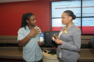 William Beckles of Little League Gym chatting with Donna Wellington, Managing Director and Country Manager, Barbados