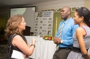 Devon Hunter and Racquel Blake of Toucan Jamaica, chats with one of the attendees at the seminar