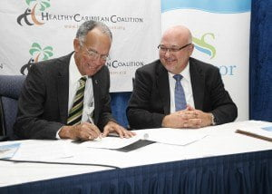 Professor Sir Trevor Hassell, President of the Healthy Caribbean Coalition and Edward Clarke, Chief Operating Officer Sagicor Life Inc and General Manager - Barbados Operations, signed a Memorandum of Understanding between the two entities in 2012, creating a partnership in regional wellness.