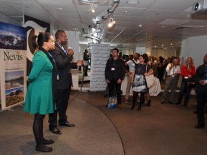 Chief Executive Officer of the St. Kitts Tourism Authority Raquel Brown looks on while Chief Executive Officer at the Nevis Tourism Authority Greg Phillip addresses patrons at The Telegraph's exclusive rum tasting event in London - 03rd October 2014.
