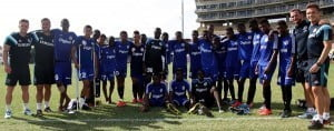 The winning team of the 2014 Digicel Kickstart Academy 2014, Team Fabregas, led by International Technical Support Officer for the Chelsea FC Foundation, Steve Winnett