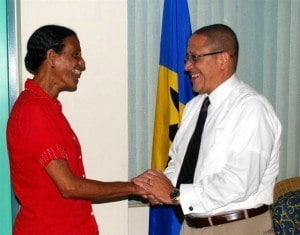 (Right) CEO of the Barbados Tourism Marketing Inc. (BTMI), Billy Griffith, endorsing June Rudder of Elite Sports (Left) as race coordinator for the 2014 edition of the POWERade Run Barbados Series.