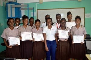 Marketing Executive for Digicel (Barbados) Limited, Shakida Grant, poses with students who attended the 4-week programme following a presentation of certificates of participation.