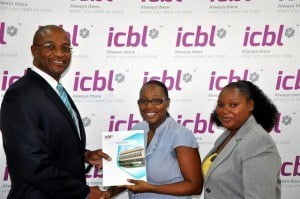 {From Left} Mr. Henry Inniss - Senior Vice  President & Head of the Life Division presents the RRSP contract to Ms. Tanya Best (SPECTACLES) while Sales Agent Marcelle Holder shares in on the victory