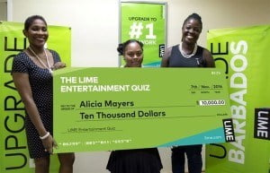 A beaming Alicia Mayers (centre) collects her prize from LIME's Marilyn Sealy (left) and CherylAnne Bascombe.