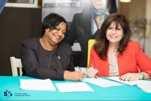 Regina LaBega (L), SXM managing director, with Maria Sastre, President and COO for Signature Flight Support, at the signing of the new concession and lease agreement on Wednesday 19th November, 2014.