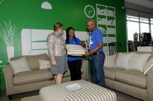 Assistant store manager, Janicho Bissette (centre) shows Victor Best Standard's selection of throw cushions while CEO, Katrina Newton looks on.