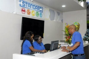 Customer Victor Best chats with Standard team members (from left) Ramona Linton and Earlene Worrell.