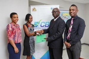 Anderson Lowe, Manager of the CBTF Management Unit (second right) presents Shernell Marshall of the Potter Centre with the first injection of funding for their project with the BHTA. The Potter Centre and the BHTA, represented here by Janelle Murray (left), have partnered to implement a management training programme for 300 supervisory and management employees across the tourism and hospitality sector. Paul Murphy, Programme Director, Ministry of Education looks on.