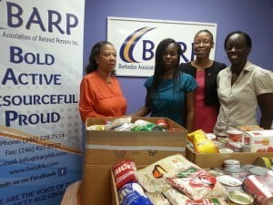 (from left) Mrs. Hazel Norville, Chairperson of the Social Activities Committee, Ms. Stacia Whittaker, HIV/AIDS Food Bank Manager, Ms Karen Barker BARP Business Development Officer and Ms Astrid Burke BARP Volunteer Coordinator