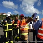 St. Maarten fire department firefighters arrive and were debriefed by on-scene commander Mr. Webster.