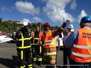 St. Maarten fire department firefighters arrive and were debriefed by on-scene commander Mr. Webster.