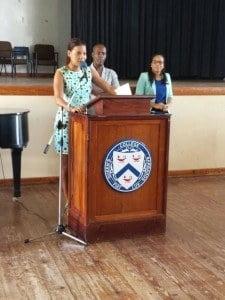 Mistress of Ceremonies; Alex Jordan speaking to students as Principal Dr. David Brown and RCSB Director Ms. Kimberley Brathwaite look on.
