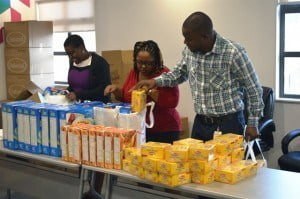 Digicel staff working together to pack the hampers