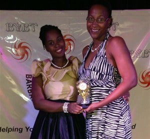 Cardell Fergusson of BYBT (left) poses with female young entrepreneur of the year, Nicole Forde-Niles at its awards ceremony for Global Entrepreneurship Week hosted at CIBC FirstCaribbean recently.