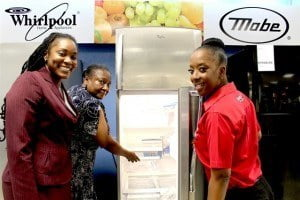 Lucky winner Beverley Harewood gets a look inside her new Whirlpool fridge with assistance from Arlene Floro (left) Marketing Manager- Unicomer Barbados Limited, and KFC Marketing Coordinator Shekelia Barrow.