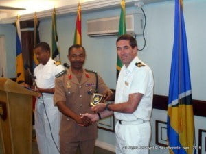 Chief of Staff of the Barbados Defence Force presents a commemorative plaque to Lieutenant Commander Howard Clark, leader of the visiting RN Maritime Training Team for sharing their expertise