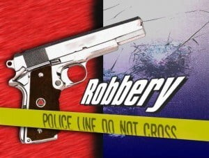 A masked man, armed with a firearm, entered the bank and stole an undisclosed sum of money. No one was injured.  The culprit escaped and ran towards Deacons Road.