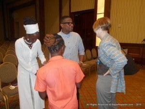 """Elvin Ross (spectacles) interacting with audience after screening of """"Kunta Kinteh Island"""" at Hilton Barbados"""