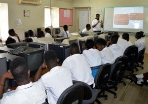 Students taking in information from Senior Engineer at Digicel, Kerry Farnum.