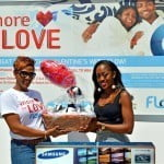 Marketing Executive Ms. Julie Jones left with Grand Prize Winner Ms. Jalissa Harris