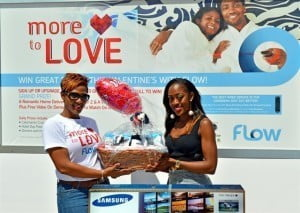 Marketing Executive, Ms. Julie Jones (left) with Grand Prize Winner Ms. Jalissa Harris