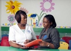 Nurse, Virginia Leandre-Broome chats with senior nursing officer, Marita Harris (right).