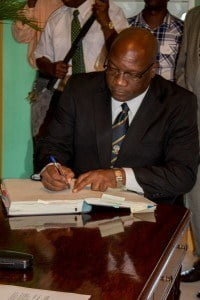 Prime Minister Dr. Timothy Harris signs documents