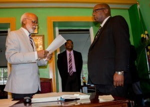 Governor General His Excellency Sir Edmund Lawrence (right) presents instrument of appointment to Prime Minister Harris