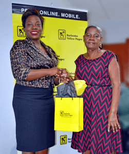 At left Sabrina Greenidge Marketing Assistant - Barbados Yellow Pages presents one of the prizes to Dorcas Ifill