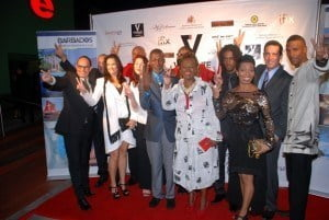 Step By Step Producers Dave and Marcia Weekes with Vigilante Cast Kirk Brown, Malissa Alanna, Claudette Wadman, Adrian Green, David Gill, Shawn Hercules, RPB, Danny & Julie Chalbaud give V sign on red carpet.