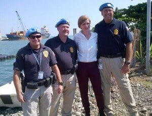The United States Permanent Representative to the United Nations, Ambassador Samantha Power and members of United Nations peacekeeping mission at the Haitian Coast Guard base in Cap Haitian, with Antillean Marine Shipping Corporation vessel RUMBA in the rear.